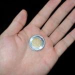 手に握らされた1ドルコイン