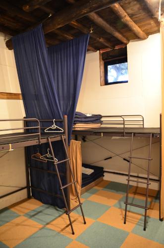 カンデラゲストハウスのドミトリー用ベッド