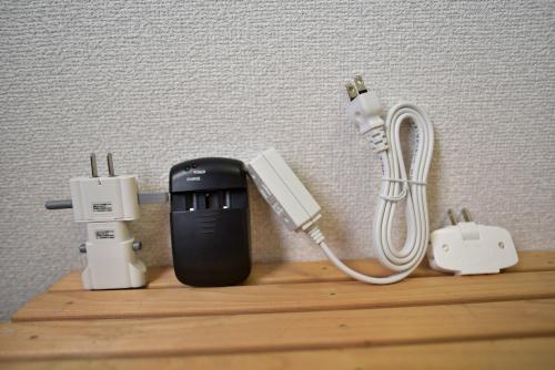 変換プラグ、万能充電器、延長コード、タコ足コンセント
